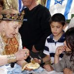 People in celebrate the Jewish Maroccan holiday of Mimouna Sacher Park in Jerusalem
