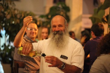 Pini Gorelick raises a toast with his homemade etrog liquor. Credit: Daniella Cheslow.