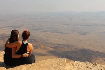 Two Career Israel participants take in the view at Mitzpe Ramon. Photo by Jess Satin.
