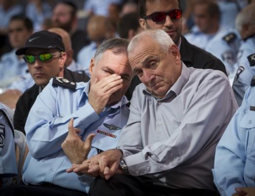Interior Minister Yitzhak Aharonovitch (R) speaks with Chief of Police Yohanan Danino (L), Nov. 2014. Credit: Miriam Alster/Flash90.