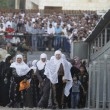 Palestinian women pass an Israeli West Bank checkpoint. Credit: AP.
