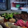 A group sleeping next to the street in Kathmandu, Nepal. Credit: EPA/NARENDRA SHRESTHA.