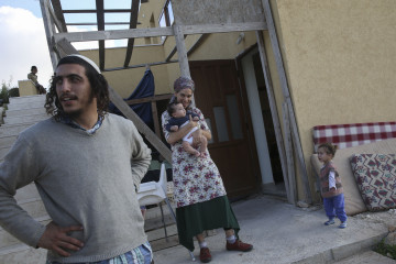 A Jewish family stands outside its house in the settlement of Bat Ayin. Credit: Nati Shohat/Flash90.