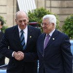 Israeli Prime Minister Ehud Olmert meets with French President Nicolas Sarkozy and Palestinian Authority Minister Mahmoud Abbas at the Elysee Palace in Paris
