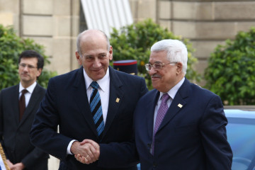 PM Olmert and President Abbas meet in Paris, July 2008. Credit: Thaer Ganaim/Flash90.
