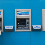 Man cashing out money from Bank Leumi machine. Photo by Nati Shohat/Flash90